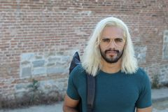 Ethnic man with blonde dyed long hairstyle.  royalty free stock photos