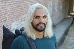 Ethnic man with blonde dyed long hairstyle.  royalty free stock image