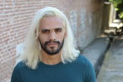 Ethnic man with blonde dyed long hairstyle.  royalty free stock photography