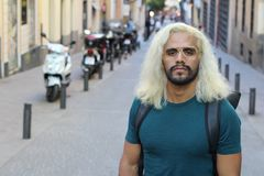 Ethnic man with blonde dyed long hairstyle.  stock photography