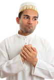 Ethnic man holding his hands to his chest Royalty Free Stock Photography