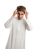 Ethnic man in robe and hat Stock Photos