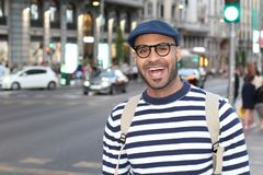 Ethnic man smiling in the city.  royalty free stock photography
