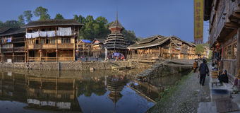 Ethnic minorities village, wooden house reflected water, Zhaoxin Royalty Free Stock Image