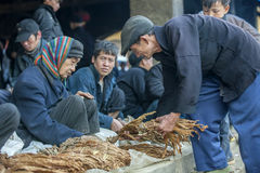 Ethnic minority man selling cigarettes, at old Van market Royalty Free Stock Image