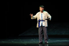 Ethnic minority men- Jiangxi opera a steelyard Royalty Free Stock Image