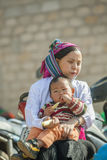 Ethnic minority mother and son, at old Dong Van market. Ha Giang province, Vietnam. Ha Giang is one of the six poorest provinces of Vietnam. Ha Giang is a Royalty Free Stock Photo
