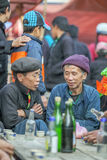 Ethnic minority two men talking to each other, at old Dong Van market Royalty Free Stock Photography