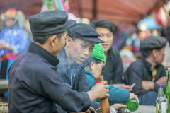 Ethnic minority two men talking to each other, at old Dong Van market Stock Photo
