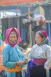 Ethnic minority two women talking to each other, at old Dong Van market Stock Photo