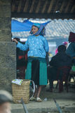 Ethnic minority woman standing, at old Dong Van market Stock Image