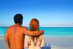 Ethnic mixed couple man woman beach vacation Stock Image