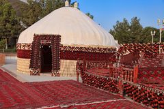 Ethnic nomadic yurt-building and trestle-bed, built for the cele Royalty Free Stock Photography