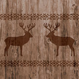 Ethnic nordic borders pattern with deer on realistic natural wood texture background. Stock Photography