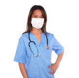 Ethnic nurse woman looking at you with a mask Stock Photos