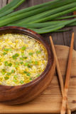 Ethnic oriental soup with dropped eggs and green Royalty Free Stock Image