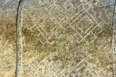 Ethnic ornament in stone. On a stone carved ethnic pattern in the form of diamonds Stock Images