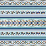 Ethnic ornamental background in blue and brown colors Royalty Free Stock Image