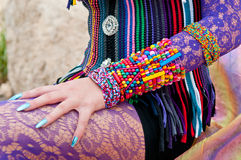 Ethnic Outfit and Accessories. Close up of tribal and ethic jewelry, clothing and accessories Stock Photos