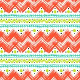 Ethnic pattern painted with zigzag brushstrokes. Vector seamless ethnic pattern hand painted with bold zigzag brushstrokes and stripes in bright colors can be Royalty Free Stock Image