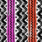 Ethnic pattern painted with zigzag brushstrokes. Vector seamless ethnic pattern hand painted with bold zigzag brushstrokes and stripes in bright colors can be Stock Image