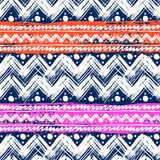 Ethnic pattern painted with zigzag brushstrokes. Vector seamless ethnic pattern hand painted with bold zigzag brushstrokes and stripes in bright colors can be Stock Photos
