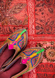 Ethnic Rajasthan shoes. Colorful ethnic shoes on red Rajasthan cushion cover on flea market in India Stock Image