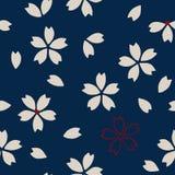 Ethnic sakura pattern. Seamless traditional Japanese sakura pattern. Cherry blossom, ecru and red on navy blue background. Ethnic textile design Stock Image