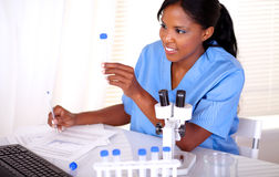 Ethnic scientific woman working with test tube Royalty Free Stock Image