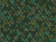 Ethnic seamless geometric pattern of triangles in the tribe style. Patchwork background for Wallpaper. Ethnic seamless geometric pattern of triangles in the vector illustration