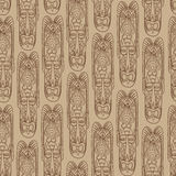 Ethnic seamless pattern. African mask tiled background. Stock Images