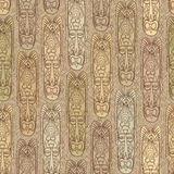 Ethnic seamless pattern. African mask tiled background. Royalty Free Stock Photo