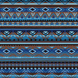 Ethnic seamless pattern. Blue, brown and black striped elements Stock Photo
