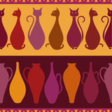 Ethnic seamless pattern with cats and vases Stock Photography