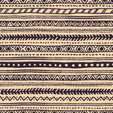 Ethnic seamless pattern. The dark horizontal stripes on a beige Stock Photography
