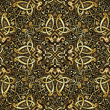 Ethnic seamless pattern. In gold and black colors. Abstract background. Oriental decorative elements. Boho style  illustration Stock Photo