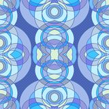 Ethnic seamless pattern made of circles and ovals. Ethnic seamless pattern in cold tones depicting circles and ovals overlapping each other, with the texture of Stock Image