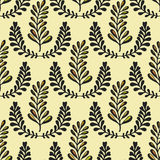 Ethnic seamless pattern with ornamental stylized leaves on yellow background. Endless texture, template for fabric Royalty Free Stock Image