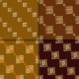 Ethnic seamless pattern set. Geometric hand drawn tribal seamless pattern set. Brown checkered abstract backgrounds. Ethnic vector ornaments Royalty Free Stock Photos