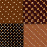 Ethnic seamless pattern set. Geometric hand drawn tribal seamless pattern set. Brown checkered abstract backgrounds. Ethnic vector ornaments stock illustration