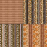 Ethnic seamless pattern set. Geometric hand drawn tribal seamless pattern set. Brown striped abstract backgrounds. Ethnic vector ornaments Stock Photography