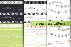Ethnic seamless patterns collection with arrows, feathers, garlands, laurel. Tribal vector patterns for design. Boho. Patterns set Vector Illustration