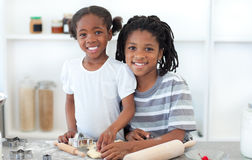 Ethnic siblings making biscuits Royalty Free Stock Photo