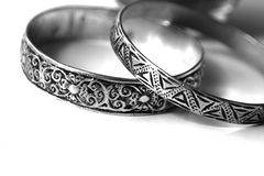 Ethnic Silver Bracelets. Two ethnic silver bracelets originating from the Sahara tribeswomen Stock Image