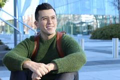 Ethnic student male smiling on campus stock photography