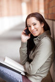 Ethnic student on the phone Royalty Free Stock Photography
