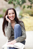 Ethnic student on the phone Royalty Free Stock Photo
