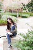 Ethnic student texting Stock Photos