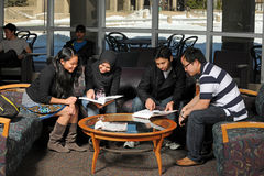 Ethnic Students Studying Stock Images