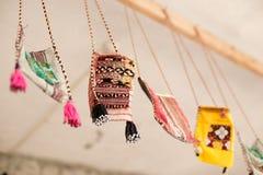 Ethnic style handmade purses. Hanging form curtain rod Royalty Free Stock Photos